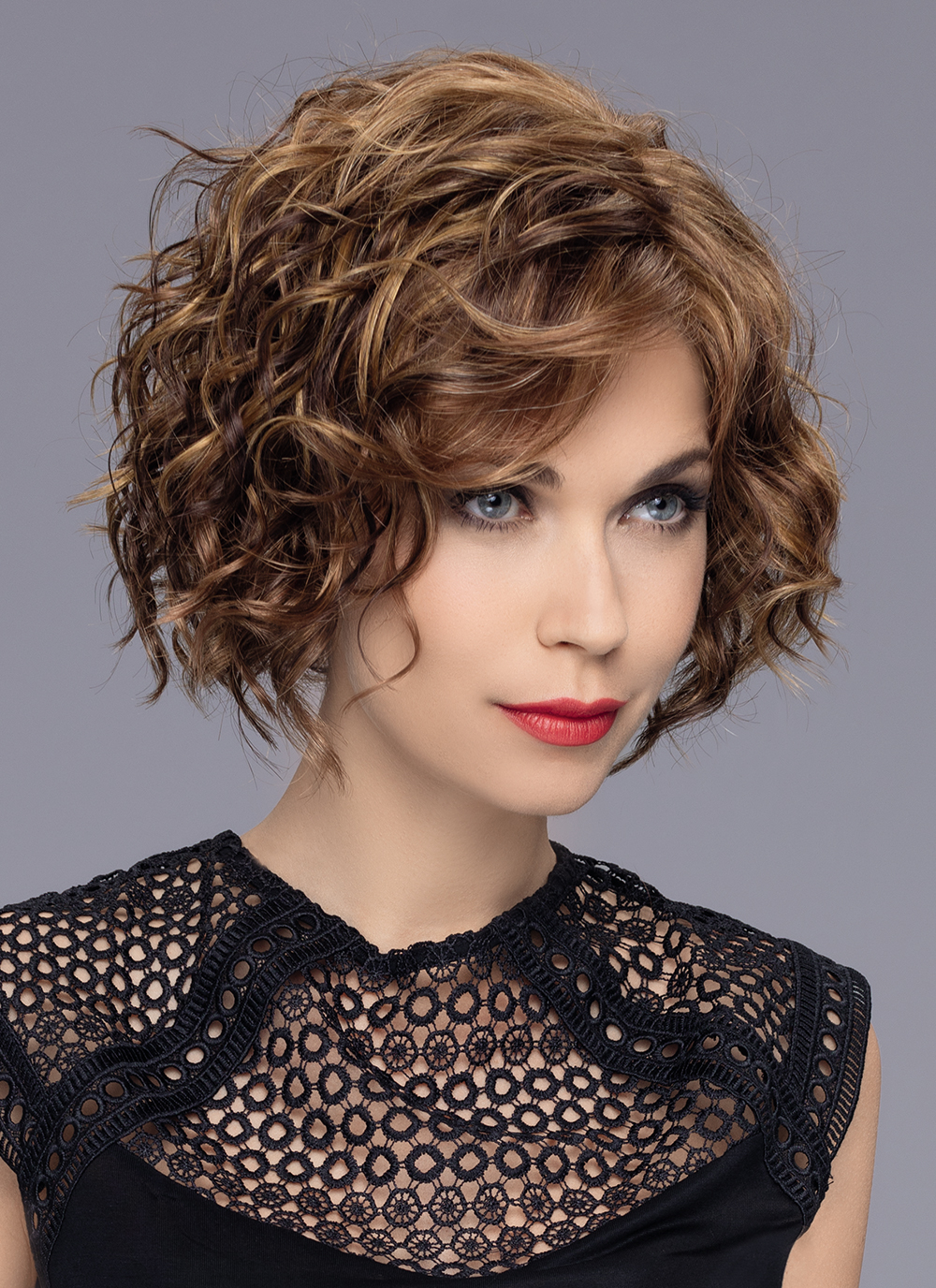 The Turn by Ellen Wille is fashionable very flattering mid-length bob with exciting curls & a perfect fringe.