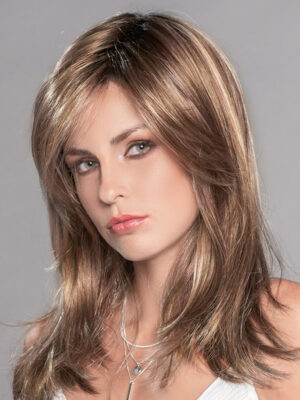 The Carrie | The monofilament crown is located behind the bang and gives a scalp-like appearance.
