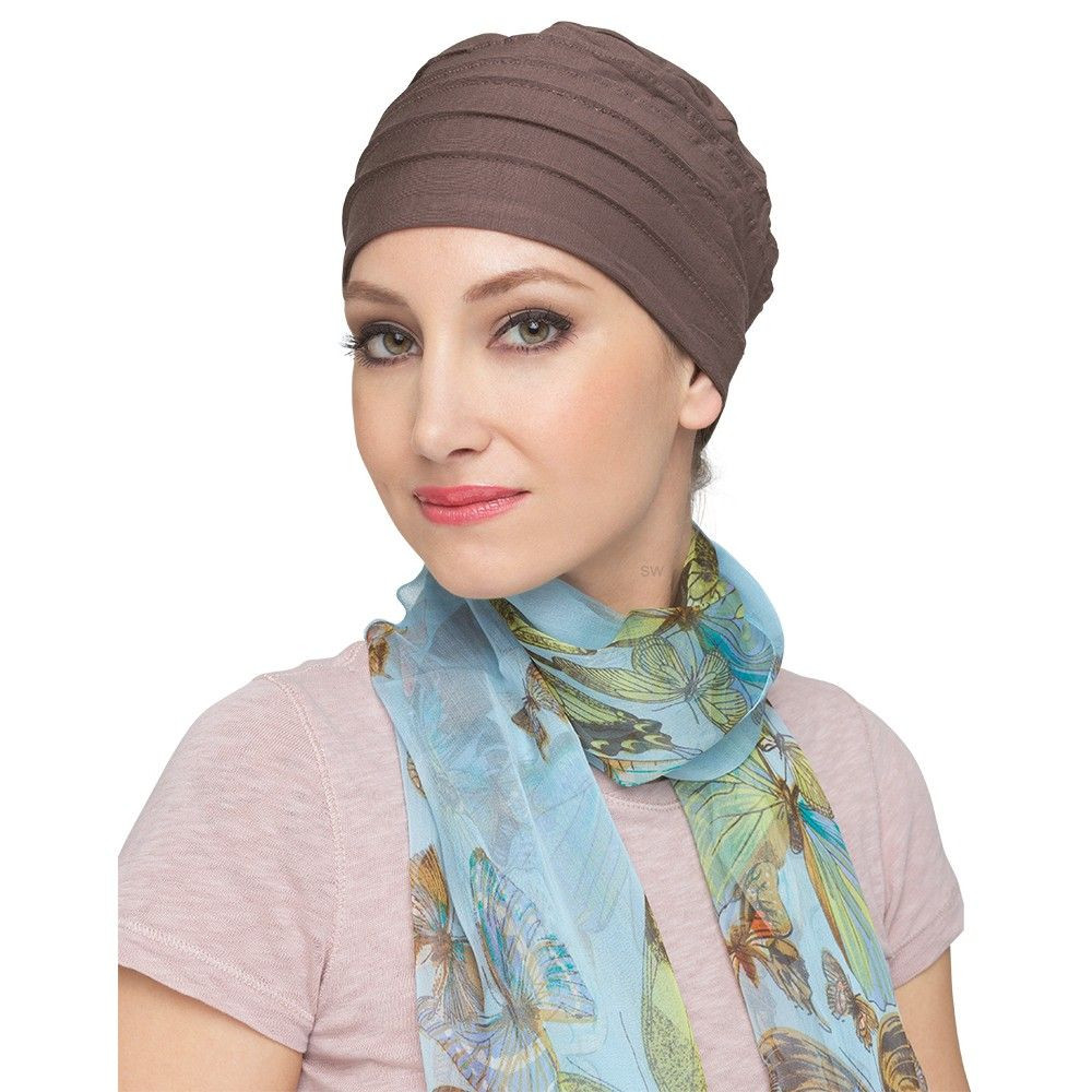 Style with horizontal pleats which add structure & shape to this turban.