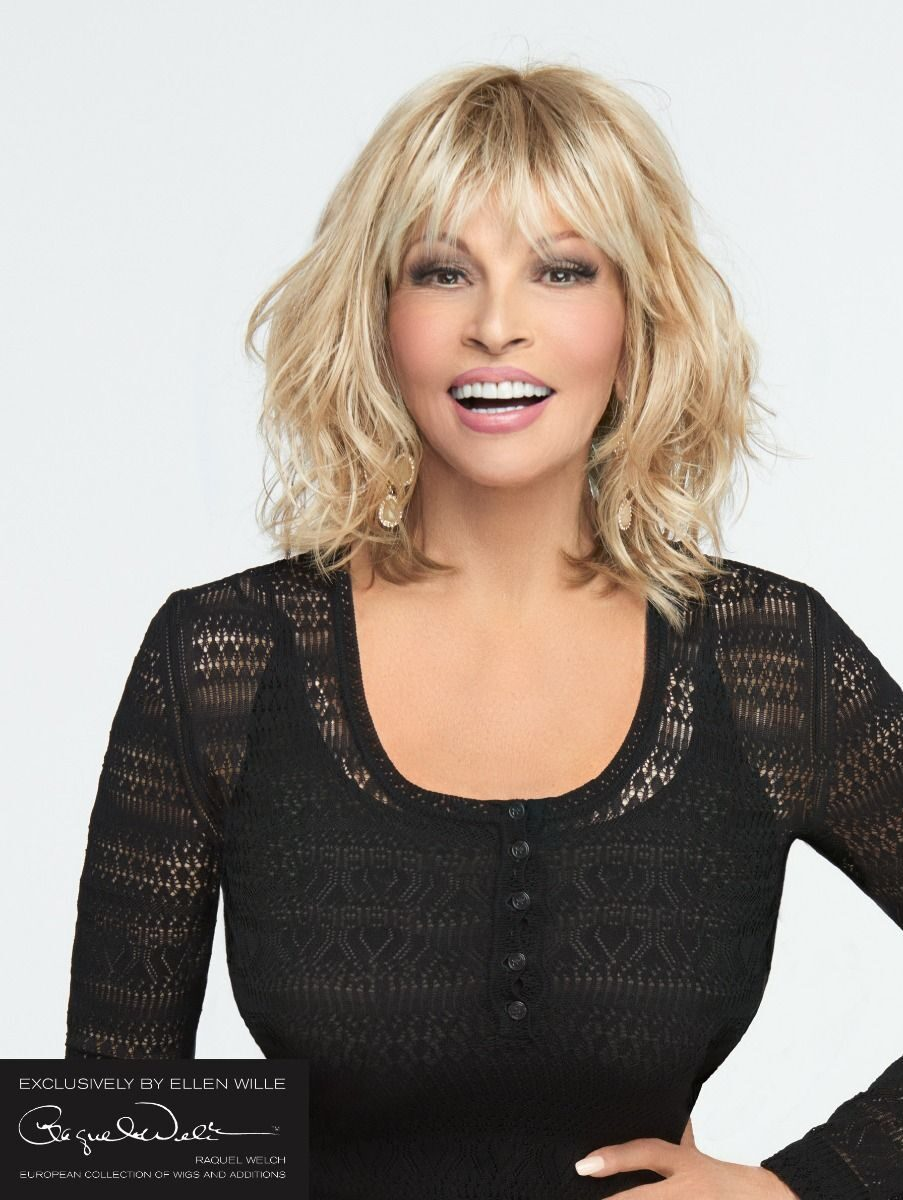 California Mono Part by Raquel Welch  The premium synthetic fiber is individually knotted on the entire top for natural movement and parting flexibility