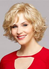 The Jules by Henry Margu | A natural wavy bob with a swept bang